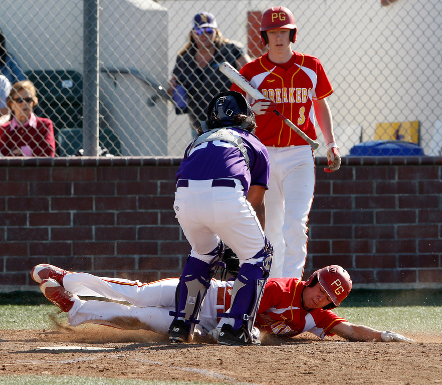 . Salinas High School\'s Colbi Lemus (2) tags out Pacific Grove High School\'s Ben Minik (15) at the plate in the second inning during their game in Salinas on Wednesday, March 28, 2018.  (Vern Fisher - Monterey Herald)