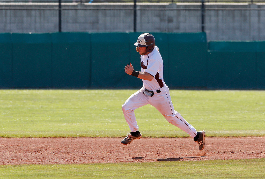 . Monterey Peninsula College\'s Kash Satnat (4) rounds second base during their game in Monterey against Chabot College on Thursday, March 29, 2018.  (Vern Fisher - Monterey Herald)