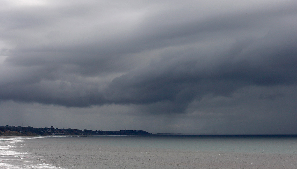 . Storm clouds roll over Seacliff State Beach in Aptos on Saturday, March 24, 2018.  (Vern Fisher - Monterey Herald)