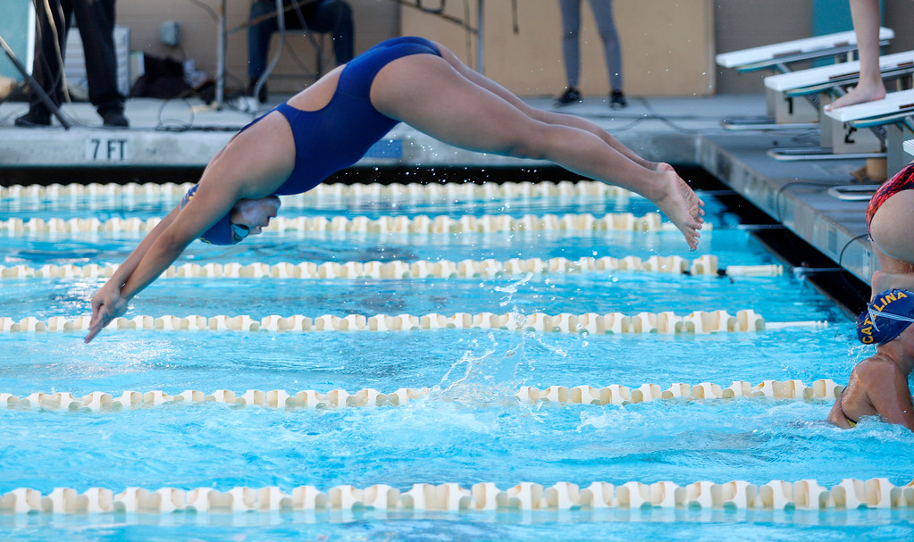. Santa Catalina School\'s Damiera Cruz gets off the blocks first as she competes in the freesyle leg of the 200 medley relay at Pacific Grove High School on Friday, March 23, 2018.  (Vern Fisher - Monterey Herald)