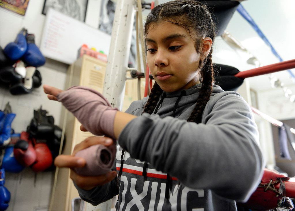 . Salinas Boxing Club fighter Maria Jardines, 14, wraps her hand prior to training at the Salinas Boxing Club on Thursday, March 22, 2018.  (Vern Fisher - Monterey Herald)