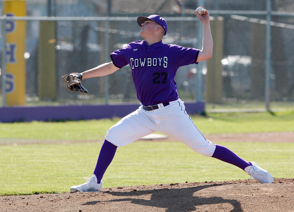 . Salinas High School\'s Nathan Chapman (27) delivers a pitch in the first inning during their game against Pacific Grove High in Salinas on Wednesday, March 28, 2018.  (Vern Fisher - Monterey Herald)