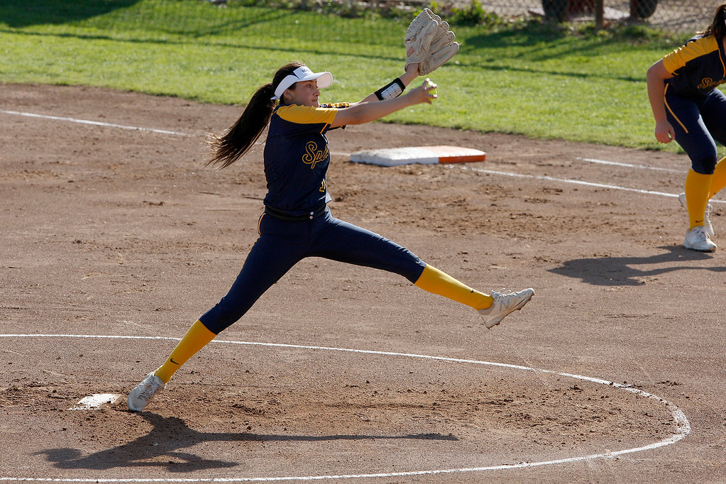 . Notre Dame Salinas starting pitcher Vanessa Gonzalez (1) delivers a pitch against Carmel High School in their softball game in Carmel on Tuesday, March 27, 2018.  (Vern Fisher - Monterey Herald)
