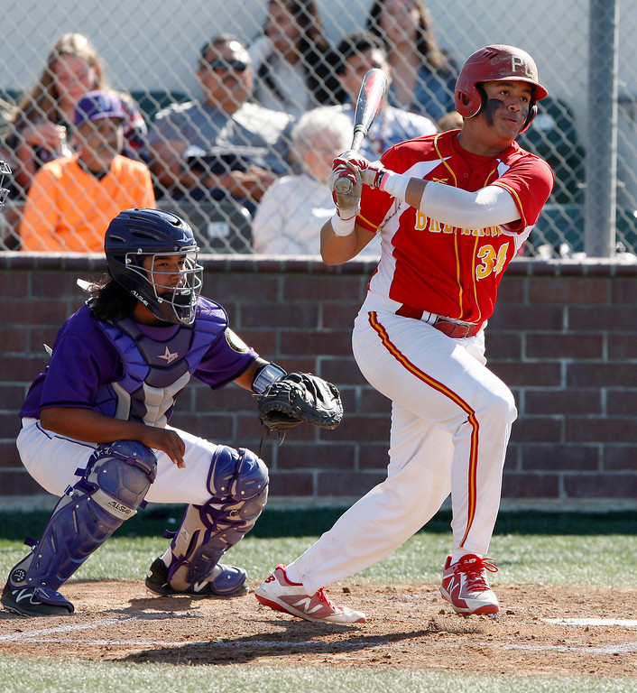 . Salinas High School\'s Colbi Lemus (2) watches as Pacific Grove High School\'s Kevahn Ebron (34) makes contact in the second inning during their game in Salinas on Wednesday, March 28, 2018.  (Vern Fisher - Monterey Herald)