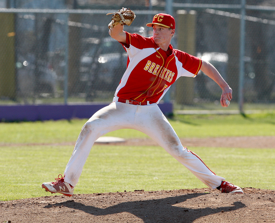 . Pacific Grove High School\'s Hunter Hanes (5) delivers a pitch in the second inning during their game against Salinas High School on Wednesday, March 28, 2018.  (Vern Fisher - Monterey Herald)