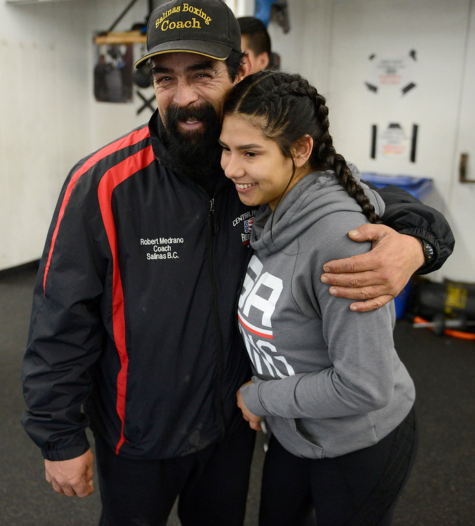 . Boxing coach Robert Medrano with fighter Iris Rivera, 17, at the Salinas Boxing Club on Thursday, March 22, 2018.  (Vern Fisher - Monterey Herald)