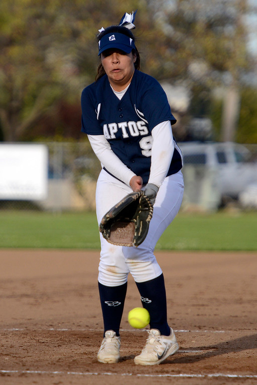 . Aptos\' Mariah Sanchez takes a hit ball to the ankle while pitching against Monterey during softball at Jacks Park in Monterey on Thursday March 9, 2017. (David Royal - Monterey Herald)