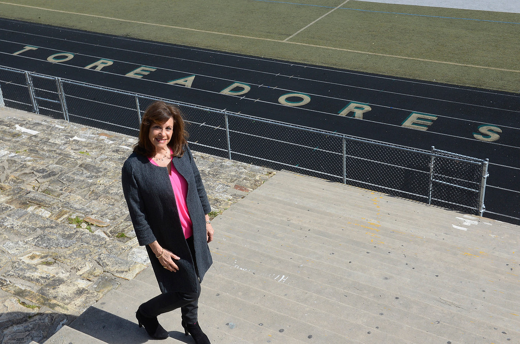. Monterey High School principal Marcie Plummer stands at the top of Dan Albert Stadium at the school in Monterey on Tuesday March 7, 2017. Plummer is leaving at the end of the school year. (David Royal - Monterey Herald)