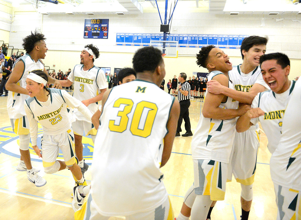 . Monterey players celebrate after their 72-56 win over Saratoga during the CCS Division III boys basketball finals at Santa Clara High School on Saturday March 4, 2017. (David Royal - Monterey Herald)