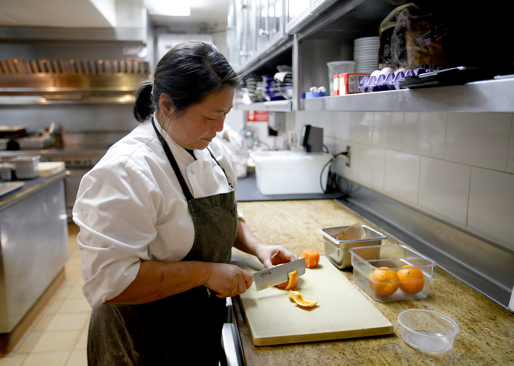 . Yulanda Santos pastry chef for Aubergine at L\'Auberge in Carmel at work on Thursday, Match 9, 2017.  (Vern Fisher - Monterey Herald)