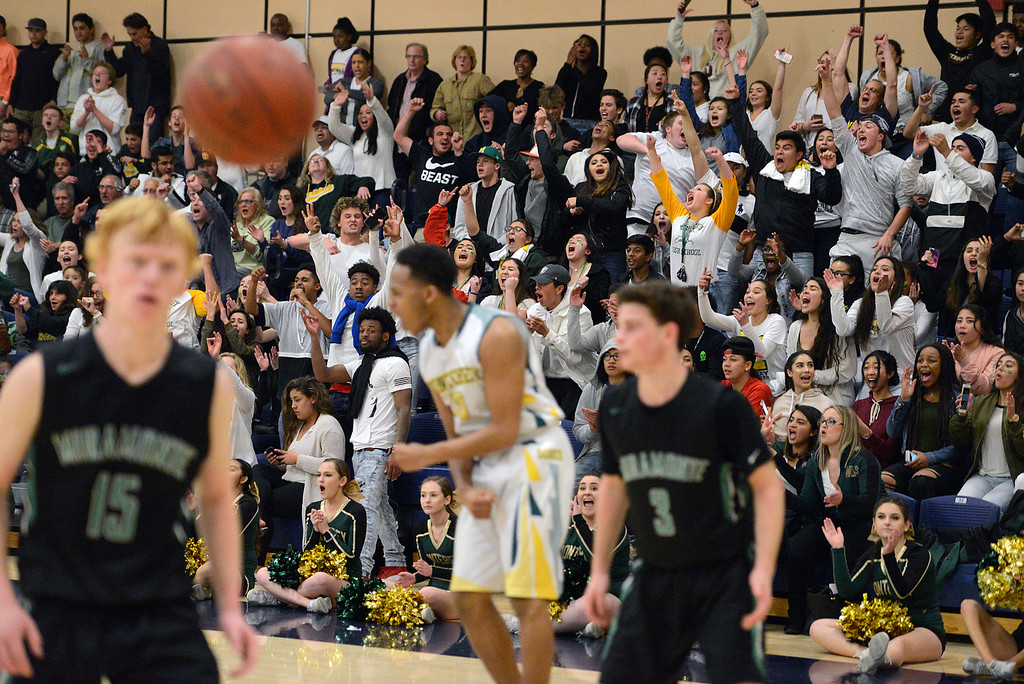 . Monterey fans react after Mohammed Adam, center, sank a basket against Miramonte in overtime during the opening round of the State Nor Cal Division III boys basketball tournament at CSU Monterey Bay on Wednesday March 8, 2017. (David Royal - Monterey Herald)