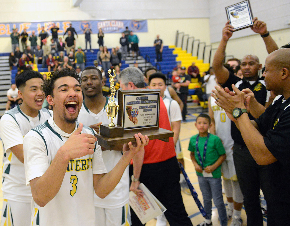 . Monterey\'s Kobe Ordonio and teammates celebrate after their win against Saratoga during the CCS Division III boys basketball finals at Santa Clara High School on Saturday March 4, 2017. (David Royal - Monterey Herald)