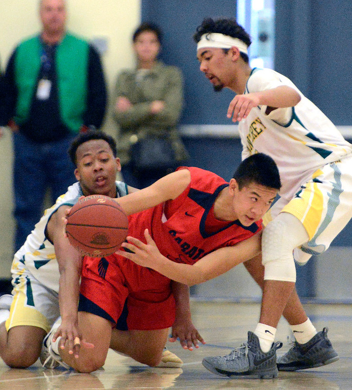 . Monterey\'s Mohammed Adam, left, and Kobe Ordonio wrestle Saratoga\'s Harrison Wong for a ball during the CCS Division III boys basketball finals at Santa Clara High School on Saturday March 4, 2017. (David Royal - Monterey Herald)