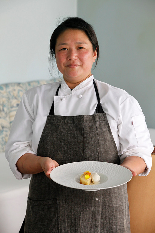 . Yulanda Santos pastry chef for Aubergine at L\'Auberge in Carmel with a honey cake with burnt honey, butter cream and honey comb candy at on Thursday, Match 9, 2017.  (Vern Fisher - Monterey Herald)