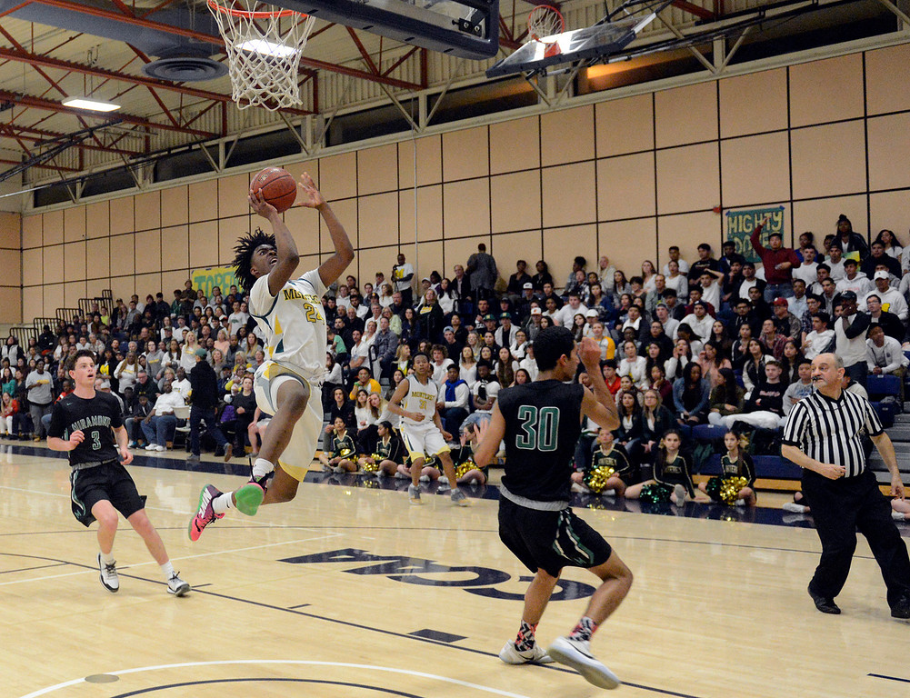 . Monterey\'s Evans Charles sinks a basket against Miramonte during the opening round of the State Nor Cal Division III boys basketball tournament at CSU Monterey Bay on Wednesday March 8, 2017. (David Royal - Monterey Herald)