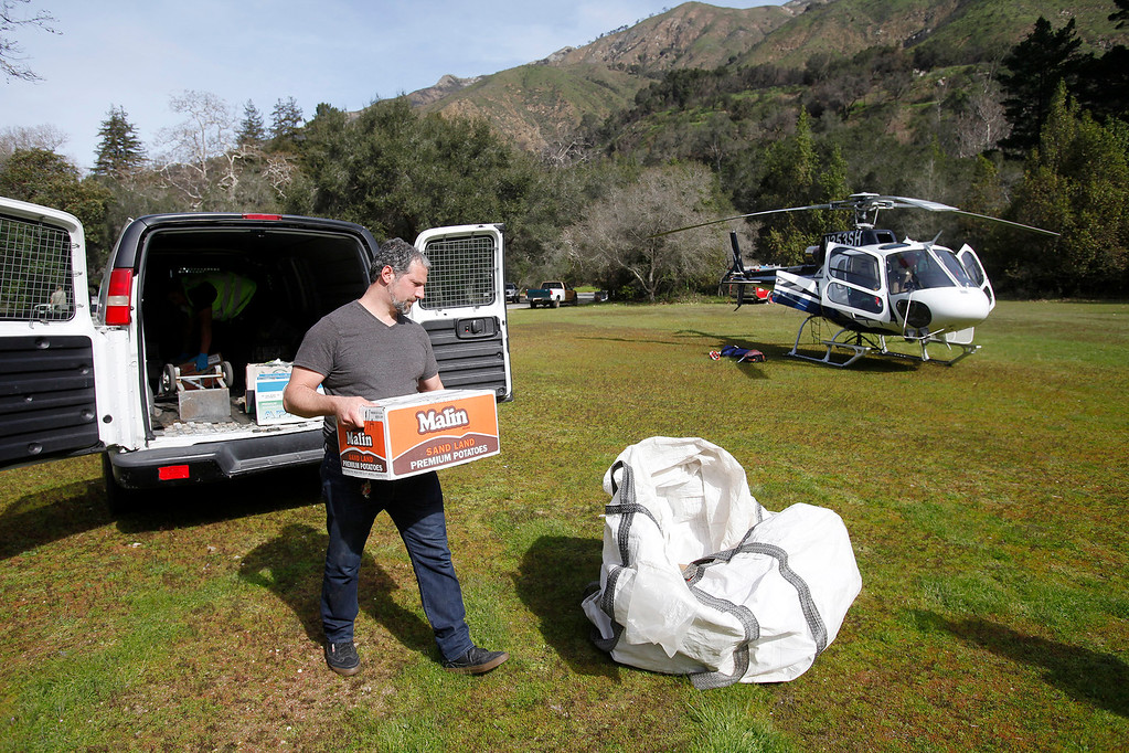 . Ventana Inn head chef Paul Corsentino loads food supplies to be airlifted from Pfeiffer Big Sur State Park to south of the damaged Pfeiffer Bridge on Friday, March 3, 2017.  (Vern Fisher - Monterey Herald)