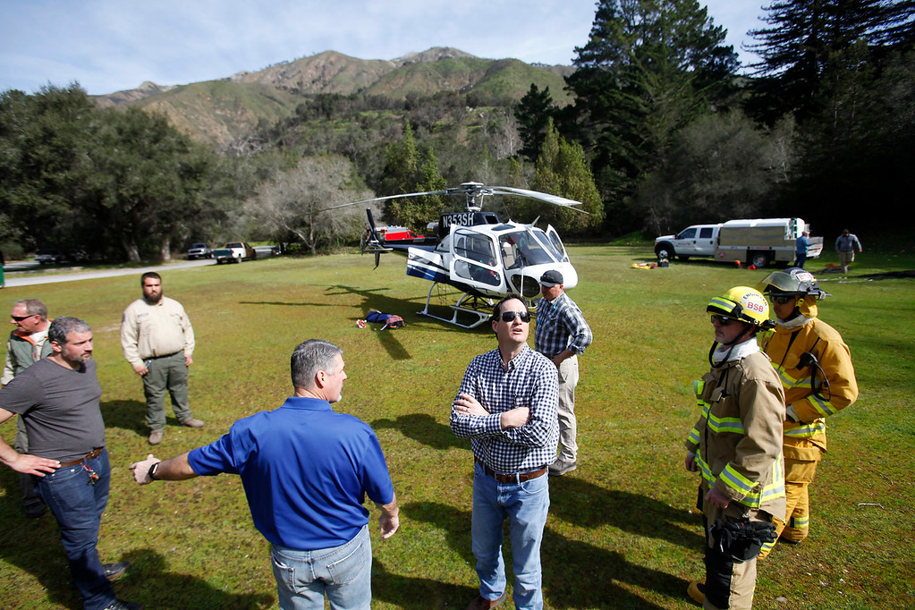 . Chief Pilot Scott Sinton (center) checks conditions prior to supplies being airlifted from Pfeiffer Big Sur State Park to south of the damaged Pfeiffer Bridge on Friday, March 3, 2017.  (Vern Fisher - Monterey Herald)