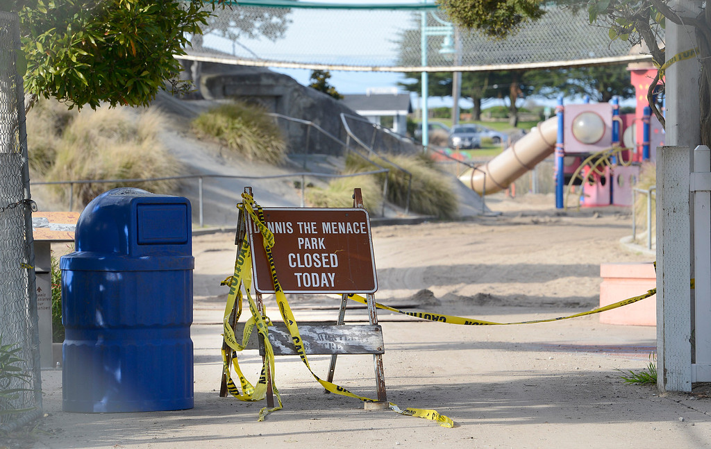 . A closed sits sign behind fencing closing the entrance to Dennis the Menace Park in Monterey on Thursday March 9, 2017. (David Royal - Monterey Herald)