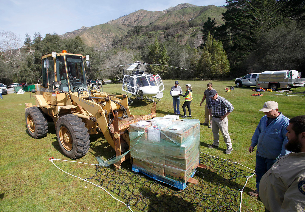 . Supplies are assembled to be airlifted from Pfeiffer Big Sur State Park to south of the damaged Pfeiffer Bridge on Friday, March 3, 2017.  (Vern Fisher - Monterey Herald)