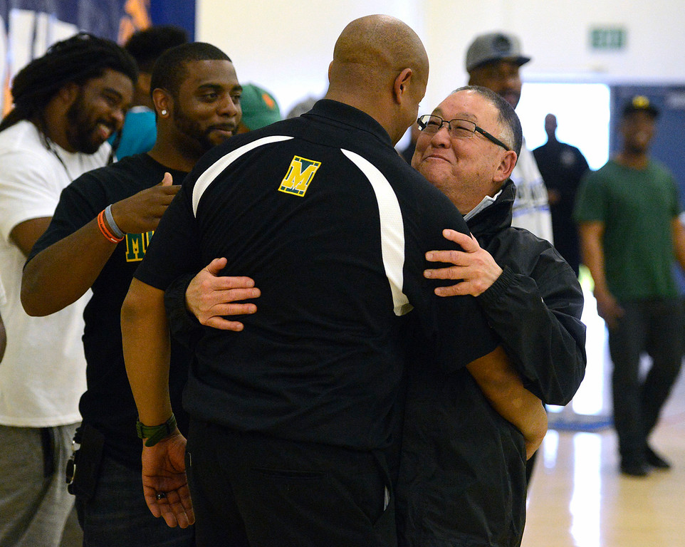 . Monterey Basketball coach Greg Daniels is embraced by water polo coach Ken Esaki after the team\'s win against Saratoga during the CCS Division III boys basketball finals at Santa Clara High School on Saturday March 4, 2017. (David Royal - Monterey Herald)
