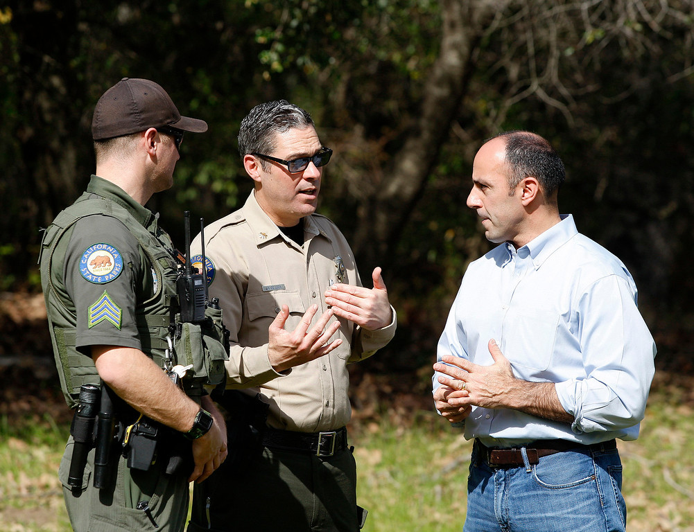 . Congressman Jimmy Panetta (right) talks with State Park officials as supplies are to be airlifted from Pfeiffer Big Sur State Park to south of the damaged Pfeiffer Bridge on Friday, March 3, 2017.  (Vern Fisher - Monterey Herald)