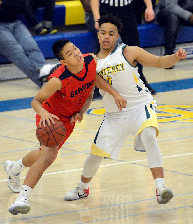 . Monterey\'s C.J. Garrett defends against Saratoga\'s Harrison Fong during the CCS Division III boys basketball finals at Santa Clara High School on Saturday March 4, 2017. (David Royal - Monterey Herald)