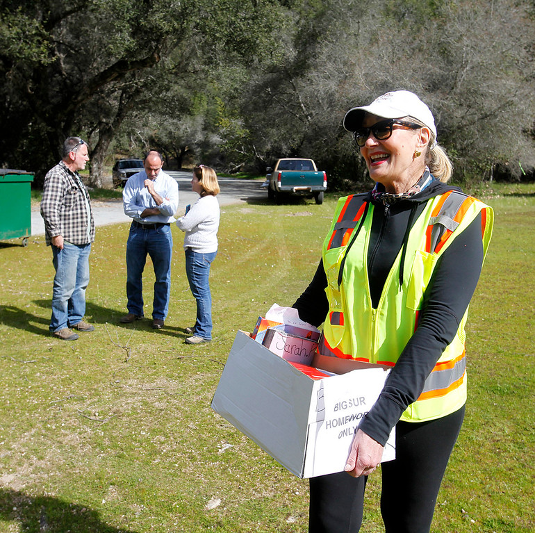 . Monterey County supervisor Mary Adams carries homework to be airlifted from Pfeiffer Big Sur State Park to south of the damaged Pfeiffer Bridge on Friday, March 3, 2017.  (Vern Fisher - Monterey Herald)