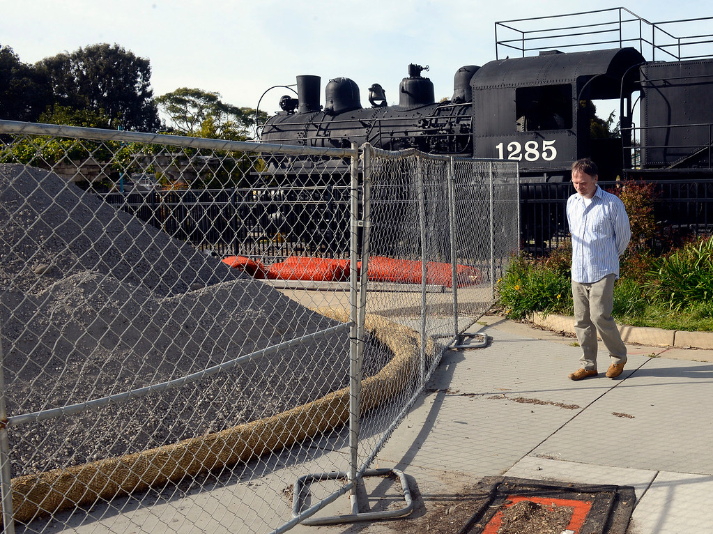 . Holger Hubbs of Pacific Grove walks past a fencing closing the entrance to Dennis the Menace Park in Monterey on Thursday March 9, 2017. (David Royal - Monterey Herald)