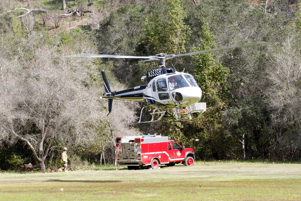 . A helicopter is used for supplies to be airlifted from Pfeiffer Big Sur State Park to south of the damaged Pfeiffer Bridge on Friday, March 3, 2017.  (Vern Fisher - Monterey Herald)