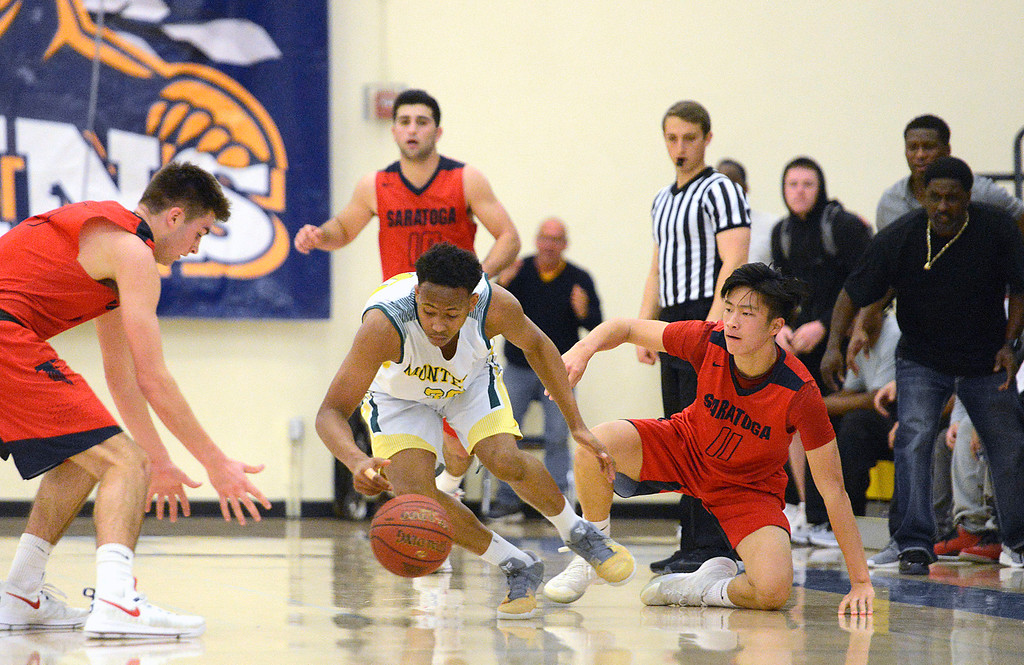 . Monterey\'s Mohammed Adam reels in a loose ball against Saratoga during the CCS Division III boys basketball finals at Santa Clara High School on Saturday March 4, 2017. (David Royal - Monterey Herald)