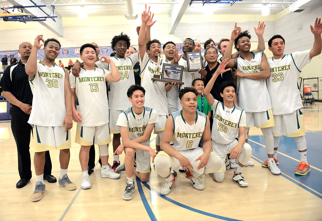 . Monterey High School Basketball Team gather after their win over Saratoga during the CCS Division III boys basketball finals at Santa Clara High School on Saturday March 4, 2017. (David Royal - Monterey Herald)