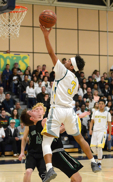 . Monterey\'s Kobe Ordonio sinks a basket against Miramonte during the opening round of the State Nor Cal Division III boys basketball tournament at CSU Monterey Bay on Wednesday March 8, 2017. (David Royal - Monterey Herald)