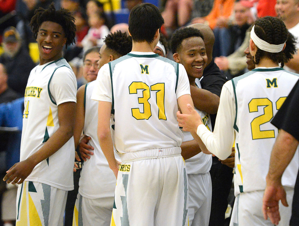 . Monterey players celebrate in the final seconds during their game against Saratoga during the CCS Division III boys basketball finals at Santa Clara High School on Saturday March 4, 2017. (David Royal - Monterey Herald)