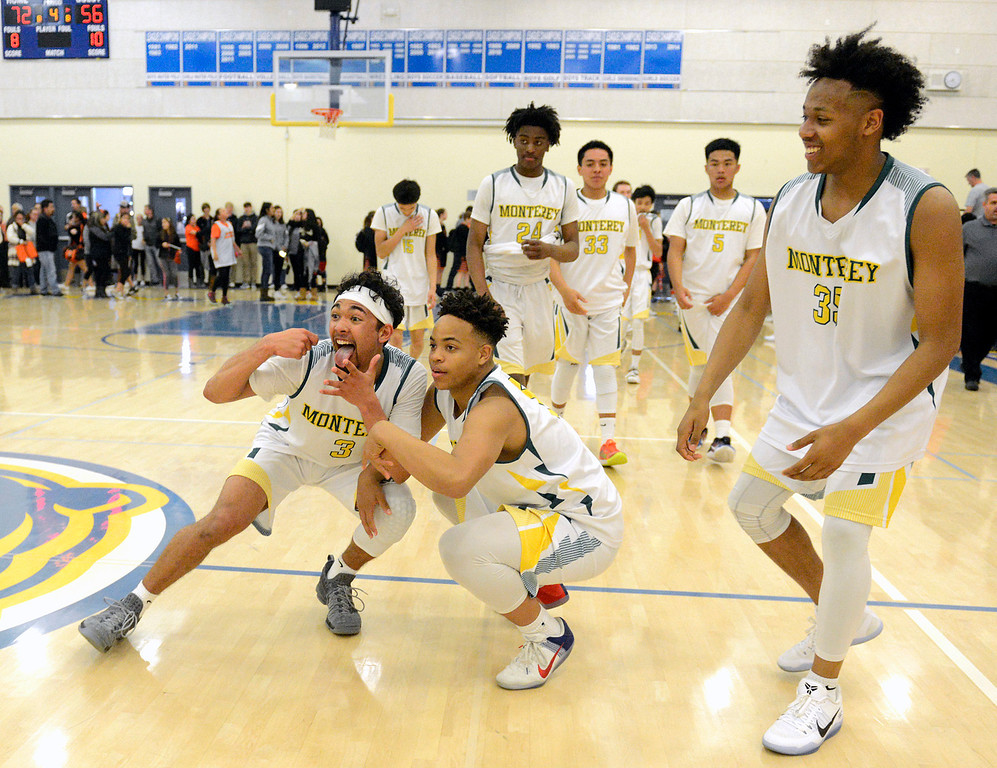 . Monterey\'s Kobe Ordonio, C.J. Garrett and teammates celebrate after their win against Saratoga during the CCS Division III boys basketball finals at Santa Clara High School on Saturday March 4, 2017. (David Royal - Monterey Herald)