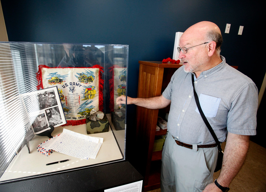 . Steven Levinson deputy director with the Fort Ord Collections and Archives & Restoration looks over their display of Fort Ord memorabilia at the Central Coast Veterans Cemetery on Wednesday, March 8, 2017. (Vern Fisher - Monterey Herald)