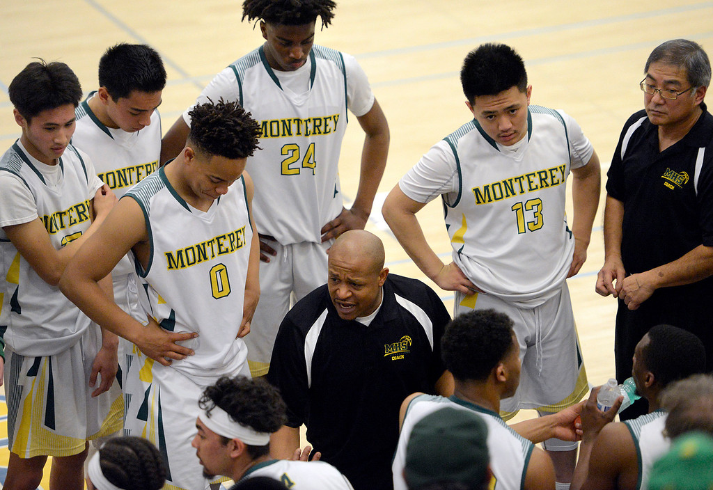 . Monterey coach Greg Daniels give instructions to his team during a time out during their game against Saratoga during the CCS Division III boys basketball finals at Santa Clara High School on Saturday March 4, 2017. (David Royal - Monterey Herald)