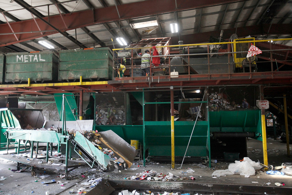 . Tom Parola with his father Gary Parola at their Monterey business on Friday, March 3, 2017.  In a time when most cities use large corporate waste management companies , the City of Monterey has maintained a unique relationship with Monterey City Waste for decades, a family-run business that utilizes the city\'s own recycling facility at Ryan Ranch. The sale of recyclables there offsets the cost of using MCW.  (Vern Fisher - Monterey Herald)