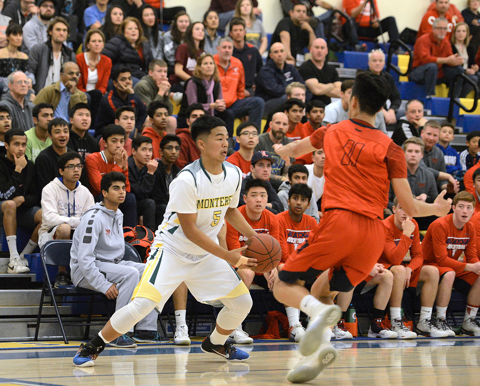 . Monterey\'s Eldrin Arelis dribbles against Saratoga during the CCS Division III boys basketball finals at Santa Clara High School on Saturday March 4, 2017. (David Royal - Monterey Herald)
