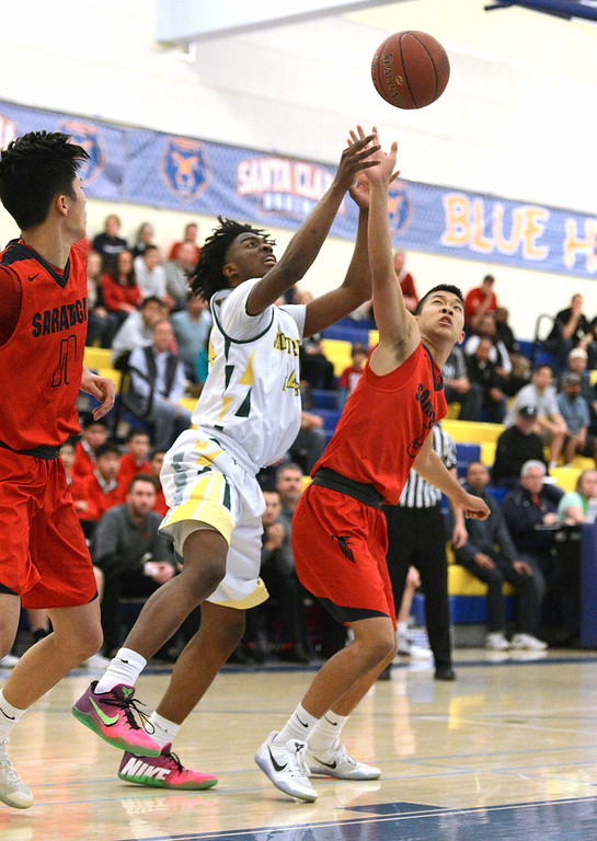 . Monterey\'s Evans Charles battles Saratoga\'s Joshua Deng for a rebound during the CCS Division III boys basketball finals at Santa Clara High School on Saturday March 4, 2017. (David Royal - Monterey Herald)