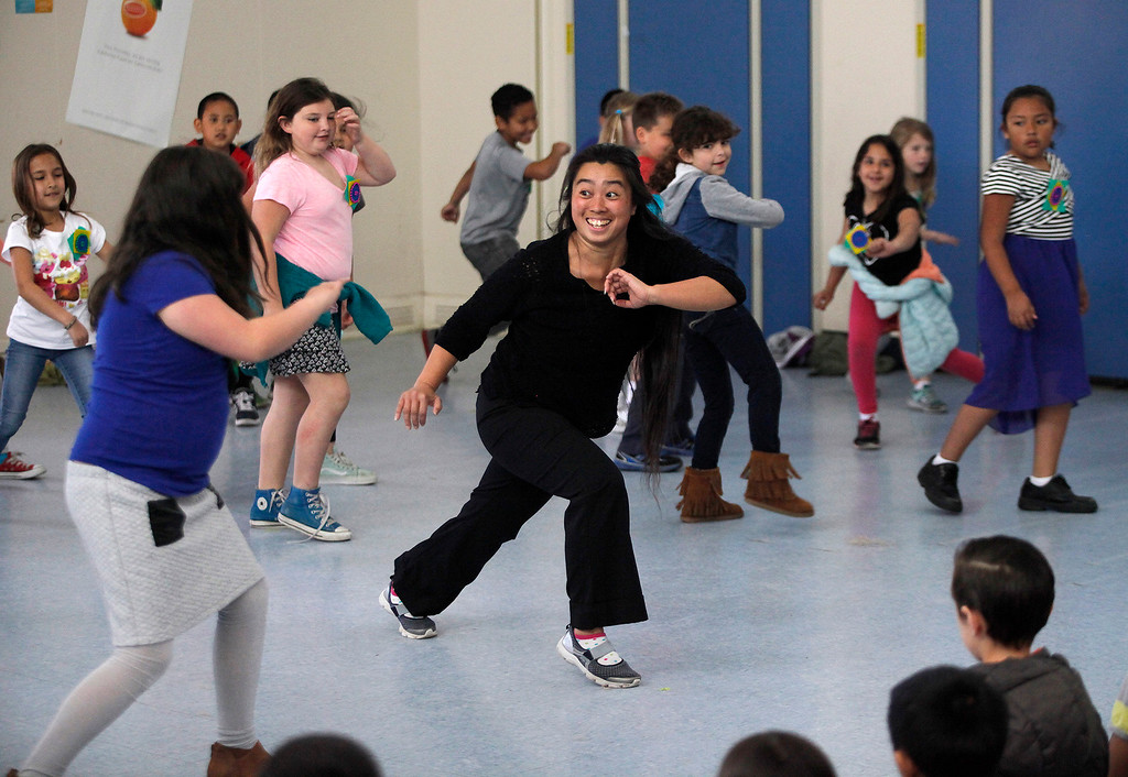 . Creative performer Saki Tamao dances with students at Monte Vista School in Monterey on Wednesday, March 8, 2017.  Members of the Tandy Beal and Company performed a variety of dances for the elementary school students.  (Vern Fisher - Monterey Herald)