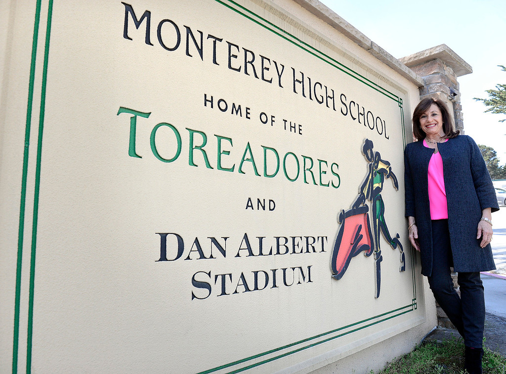 . Monterey High School principal Marcie Plummer stands beside the sign outside the entryway to the school in Monterey on Tuesday March 7, 2017. Plummer is leaving at the end of the school year. (David Royal - Monterey Herald)