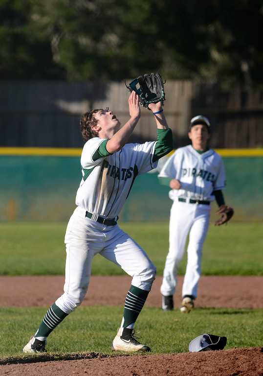 . Stevenson pitcher Taylor Balestreri reels in a pop fly against Marina during baseball in Pebble Beach on Wednesday March 8, 2017. (David Royal - Monterey Herald)