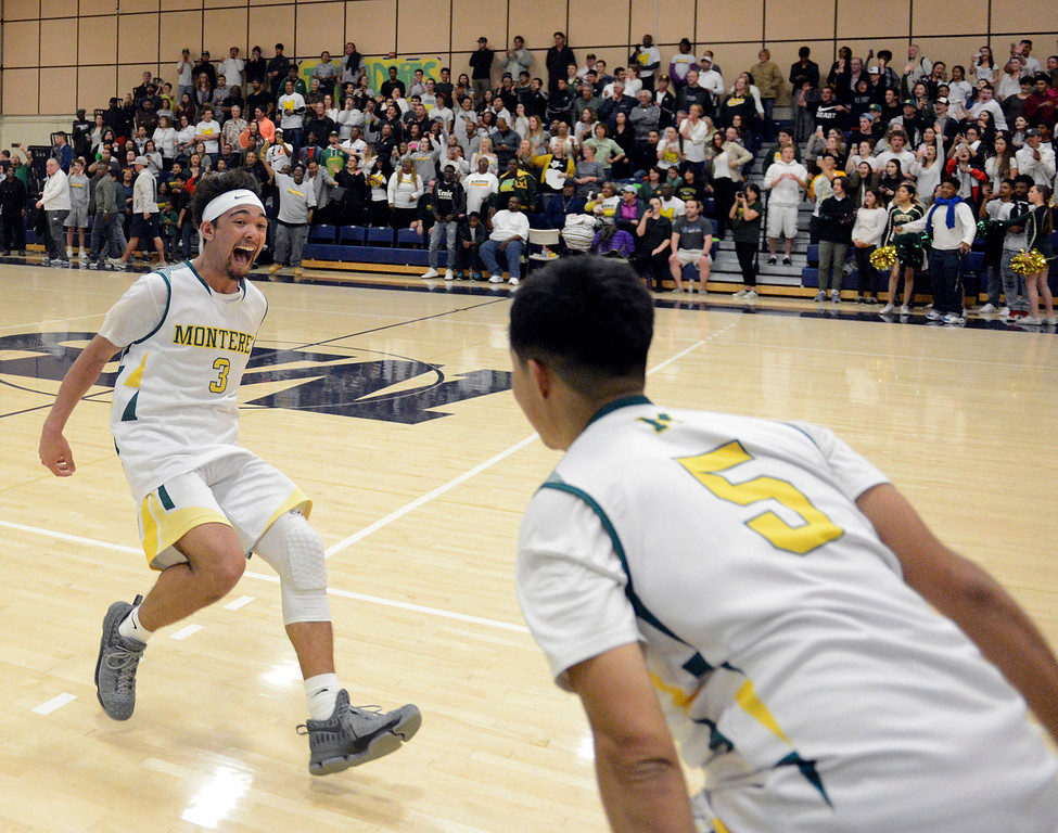 . Monterey\'s Kobe Ordonio reacts after his team\'s 63-57 win in overtime against Miramonte during the opening round of the State Nor Cal Division III boys basketball tournament at CSU Monterey Bay on Wednesday March 8, 2017. (David Royal - Monterey Herald)