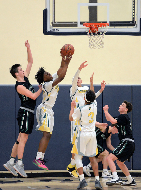 . Monterey\'s Evans Charles reels in a rebound against Miramonte for a rebound during the opening round of the State Nor Cal Division III boys basketball tournament at CSU Monterey Bay on Wednesday March 8, 2017. (David Royal - Monterey Herald)