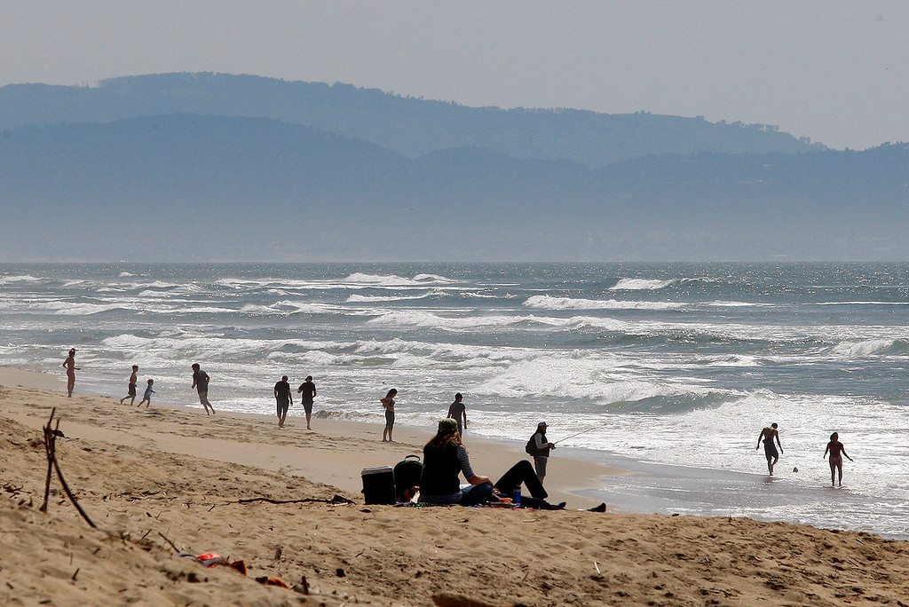. People enjoy the sunshine at Salinas River State Beach on Friday, March 30, 2018.  (Vern Fisher - Monterey Herald)