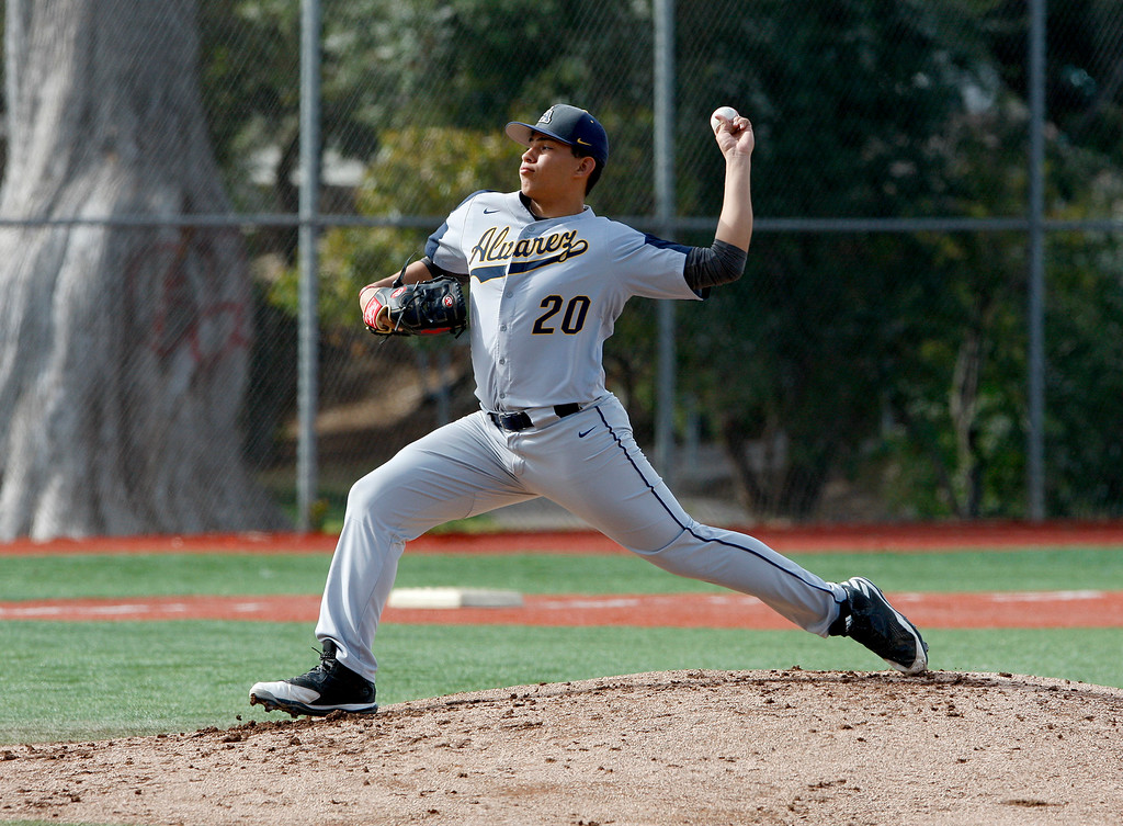 . Everett Alvarez High School\'s Angel Rodriguez (20) delivers a pitch during their game against Monterey High School in Monterey on Wednesday, March 4, 2018.  (Vern Fisher - Monterey Herald)