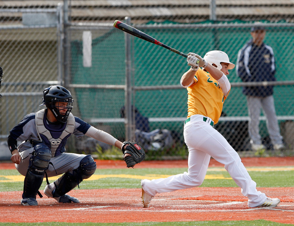 . Monterey High School\'s Michael Carnazzo (16) gets a base hit in the first inning during their game against Everett Alvarez High School on Wednesday, March 4, 2018.  (Vern Fisher - Monterey Herald)