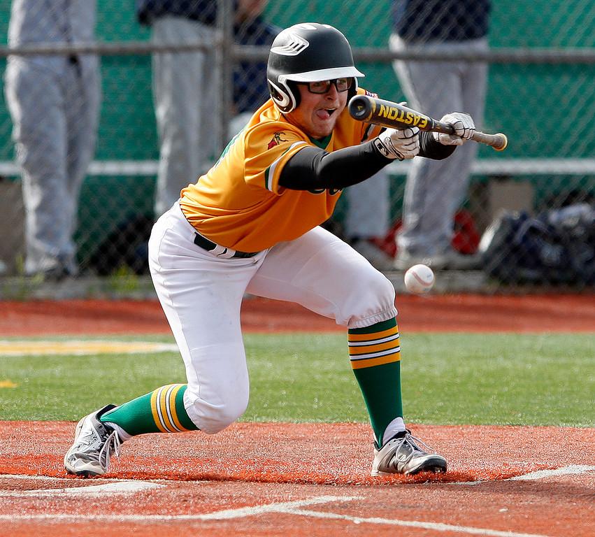 . Monterey High School\'s Jack Bailey (24) bunts in the first inning during their game against Everett Alvarez High School on Wednesday, March 4, 2018.  (Vern Fisher - Monterey Herald)
