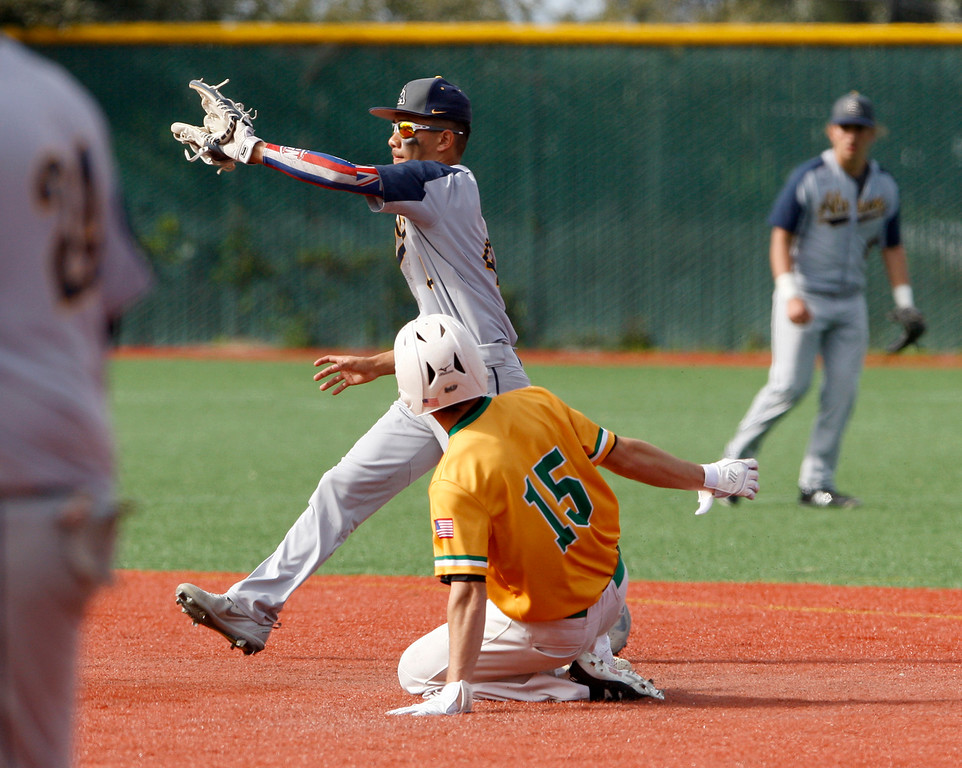 . Monterey High School\'s Michael Mugan (15) slides in safely at second base ahead of the tag by Everett Alvarez High School\'s Braden Arraga-Lopez (4) in the second inning during their game on Wednesday, March 4, 2018.  (Vern Fisher - Monterey Herald)