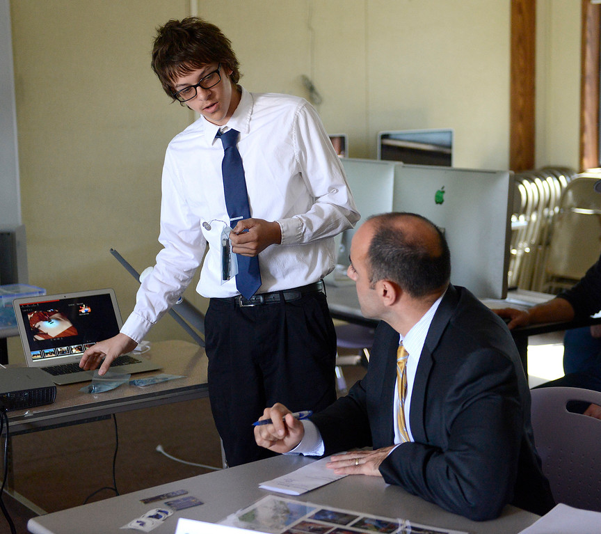 . Gonzales High School tenth grader Jerome Russell, 15, talks to Congressman Jimmy Panetta during his visit to school to meet with students who are participating in the Wings of Knowledge (WOK) program on Monday, April 2, 2018.  Students discussed the project they have been working on in collaboration with the National Oceanic and Atmospheric Administration (NOAA) and share a prototype of a system they developed to gather weather data for NOAA.  (Vern Fisher - Monterey Herald)
